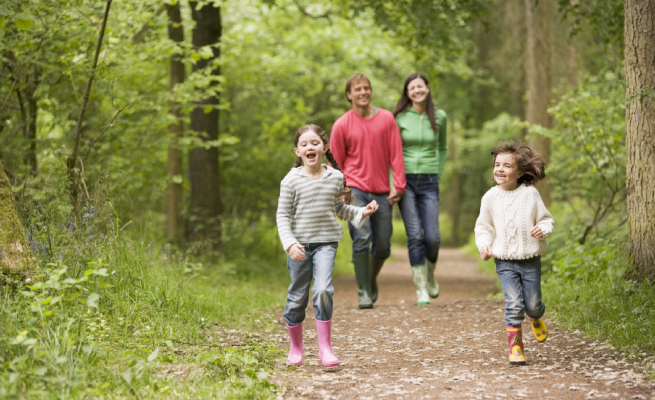 Family walking on path smiling