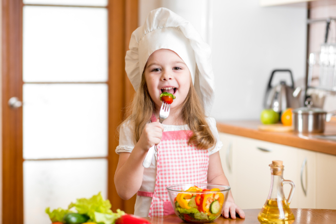 Chef kid tasting healthy food