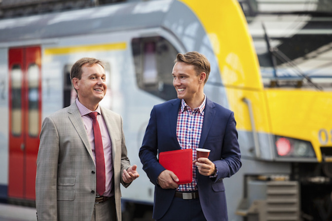 Two Businessmen at Railway Station